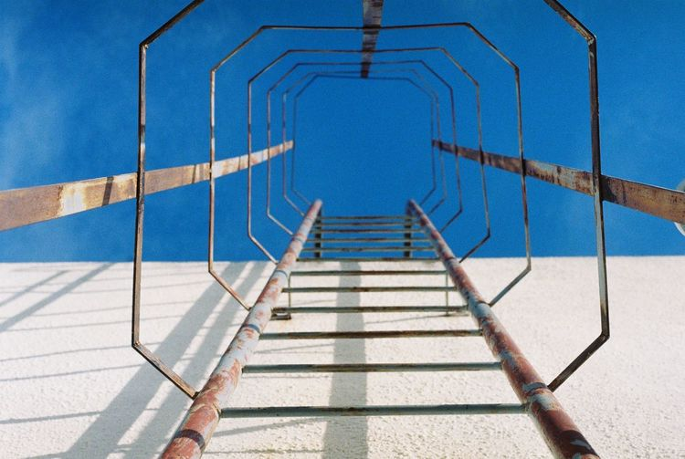 stairs to the rooftop EyeEmNewHere Absence Architecture Blue Built Structure Clear Sky Day Direction Empty Ladder Metal Nature No People Outdoors Railing Shadow Sky Staircase Steps And Staircases Sunlight The Way Forward