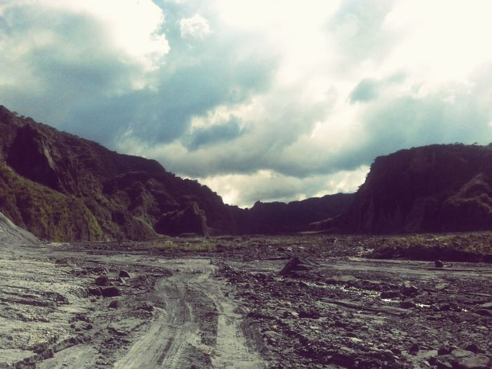 Road to a beautiful disaster. Mount Pinatubo Zambales A Beautiful Disaster'  TheCleverTraveler Cloud - Sky Landscape Dramatic Sky Outdoors Nature Mountain Rural Scene Scenics Beauty In Nature