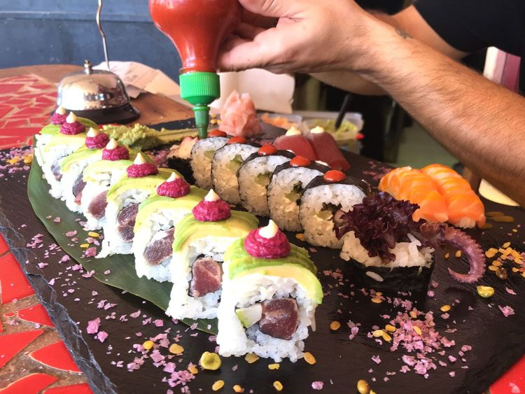 Eyeemphoto Sushi Sushi Time Making Sushi Food Foodporn Foodphotography Food And Drink Food Porn Food Photography Colors Human Hand Hand Arm Topping Decoration Fish Fresh Freshness Flowers Salt Plate View From Above Colour Of Life Ibiza