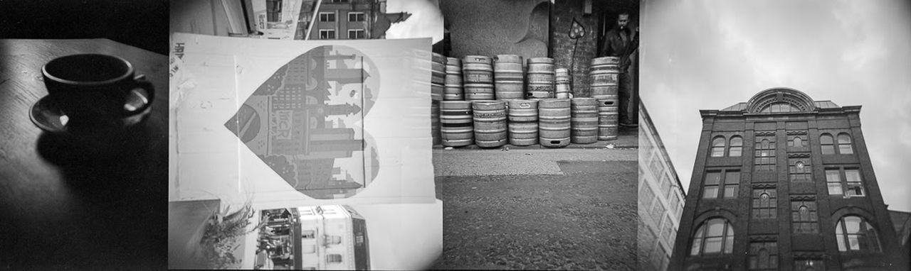 Architecture Built Structure Building Exterior No People Day Outdoors Holga120 Holga Photography Filmisnotdead Film Photography Manchester 120 Film Double Exposure EyeEm Ready   Cityscape Adult City Street Urban Skyline Blackandwhite Photography Black And White Collection  Barrels Coffee Cup
