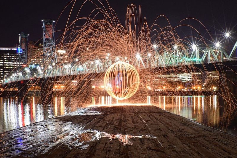 Fireball Created With Steel Wool By Illuminated Hawthorne Bridge At Night