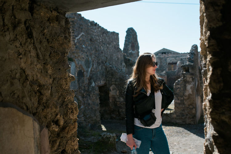 Woman standing at historical building