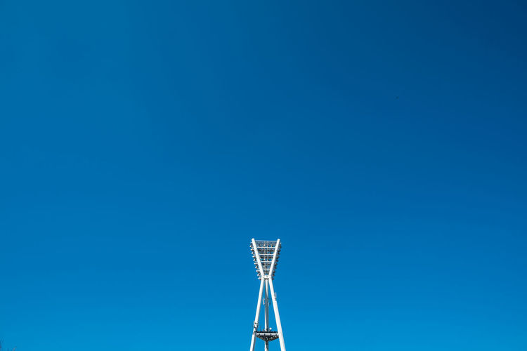 Floodlightpole Architectural Detail Architecture Architecture_collection Blue Blue Sky Cityexplorer Clear Sky Day Flood Light Pole From My Point Of View High Section Low Angle View Minimal Minimalism Minimalist Minimalistic Minimalobsession Outdoors Part Of Simplicity Sky Tall - High Urbanphotography Fine Art Photography Minimalist Architecture