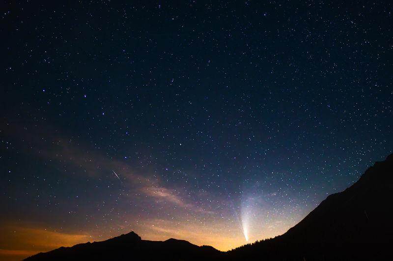 Comet neowise after sunset. the view is to feldkirch/austria. captured in malbun/liechtenstein