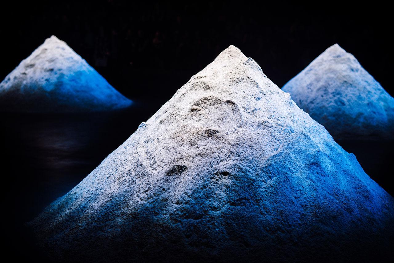 Heap of quartz powder in dark