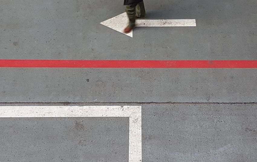 Arrow Symbol Arrow Symbol Arrow RED LINE Redline Left Leftside Traffic Arrow Sign Traffic Cone Road Road Sign Road Marking Road Marking Zebra Crossing Empty Road Asphalt Pedestrian Crossing Sign Crossing Roadways Human Foot Dividing Line Arrow Sign Directional Sign Crosswalk Human Leg Road Signal