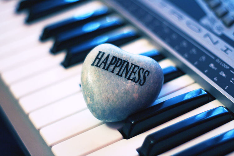 Happiness Indoors  Keyboard Music Music Pianist Piano Selective Focus Still Life Word TakeoverMusic Piano Moments