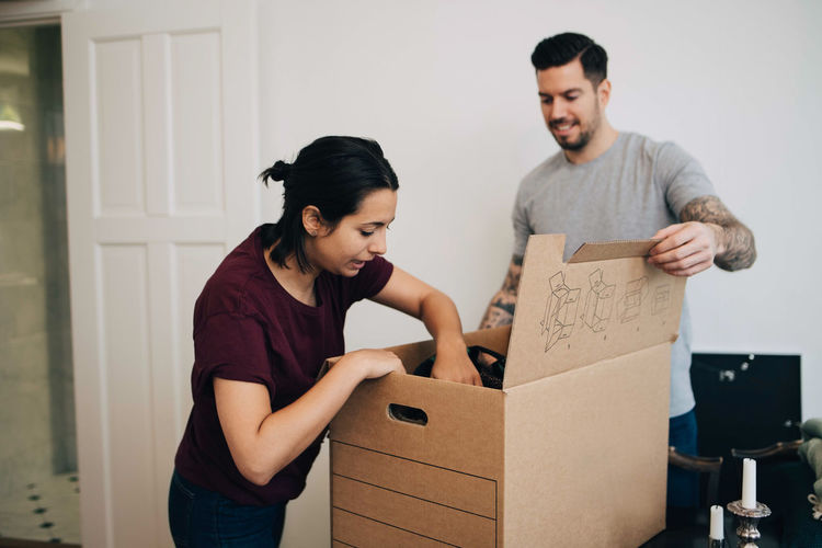 Young couple standing in box