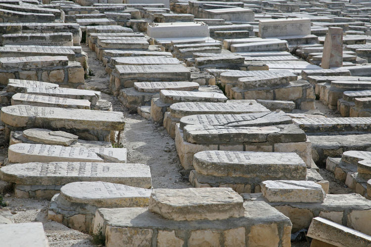 Tombstones In Jewish Cemetery On Sunny Day
