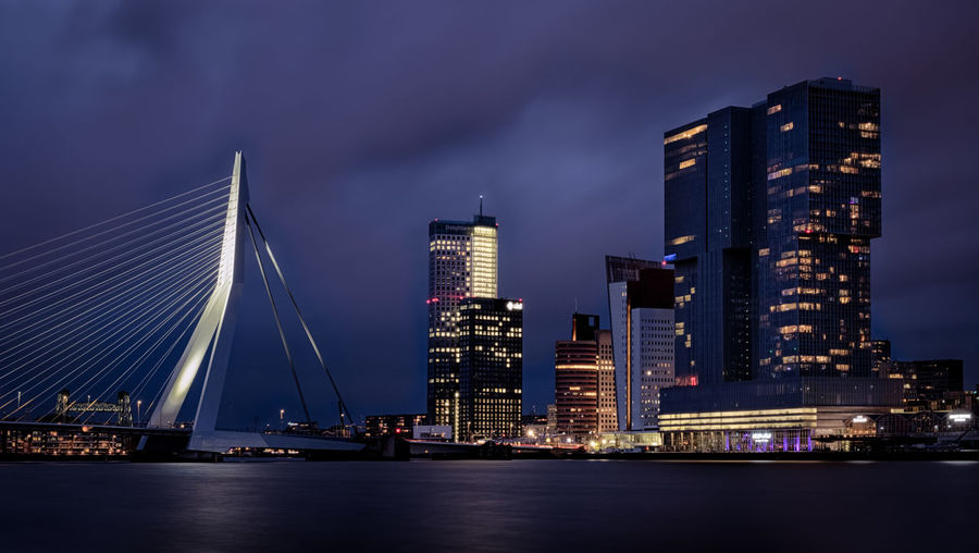 Rotterdam by night. Blue Hour Cityscape Erasmusbrug Low Light Netherlands Night Photography Rotterdam Skyline Skyscrapers The Netherlands Architecture Blue Hour Cityscape City City By Night Dutch Erasmus Holland Night Office Building Exterior River Skyscraper Water Waterfront