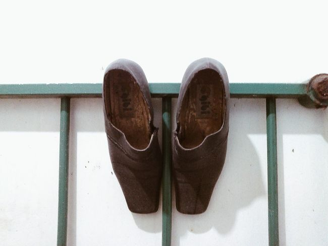 OldShoes of my mother hanging on the bedframe • Whitewall Gibishoes Pinoyphotography