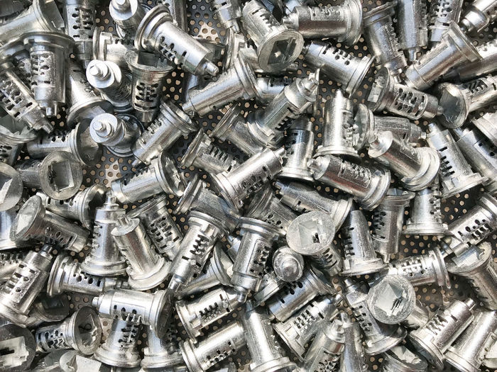 Key components Made of zinc For the key manufacturing industry. Backgrounds Close-up Components Day Full Frame Industry Key Large Group Of Objects Metal No People Nut - Fastener Outdoors Shiny Silver - Metal Silver Colored Steel Zinc