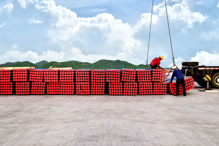 Hard working workers loading pipes from a container. Container Goods Harbor Industrial Industrial Port Logistics Business Commerce Coordination Export Import Industrial Pipes Industry Load Materials Operation Pipe Pipe - Tube Pipes Port Raw Materials Seaport Supplies Transportation Unload