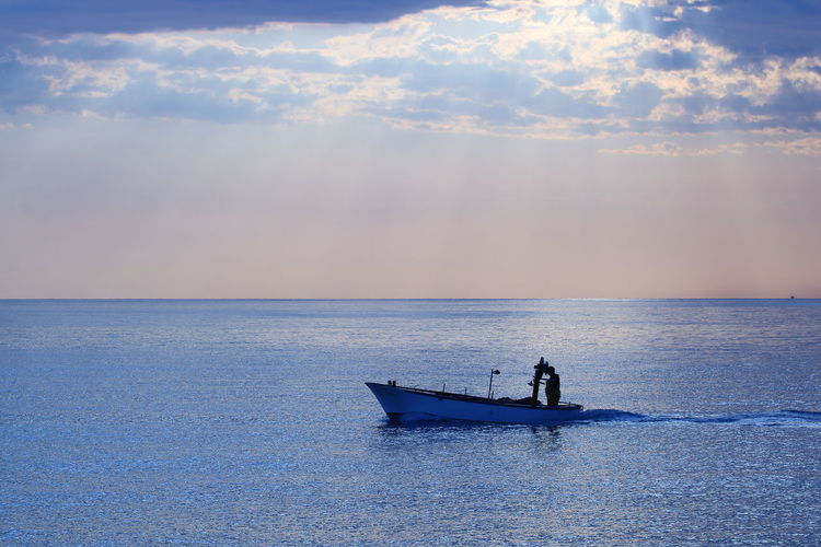 Beauty In Nature Cloud - Sky Fisherman Horizon Horizon Over Water Idyllic Men Mode Of Transportation Nature Nautical Vessel One Person Outdoors Real People Scenics - Nature Sea Sky Sunset Tranquility Transportation Water Waterfront