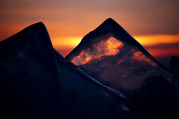 Colorful sunset light over the crystal ice block of Baikal lake. Russia Baikal Russia Frozen Ice Ice Crystal Ice Cube Sunlight Weather Winter Baikal Baikal Lake Beauty In Nature Close-up Cold Temperature Crystal Day Frozen Water Light Of My Sister Room Nature No People Outdoors Scenics Sky Sunrise Sunset Transparent