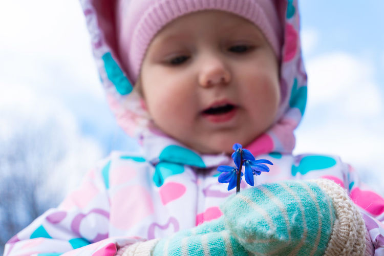 Close-up portrait of cute baby girl in winter