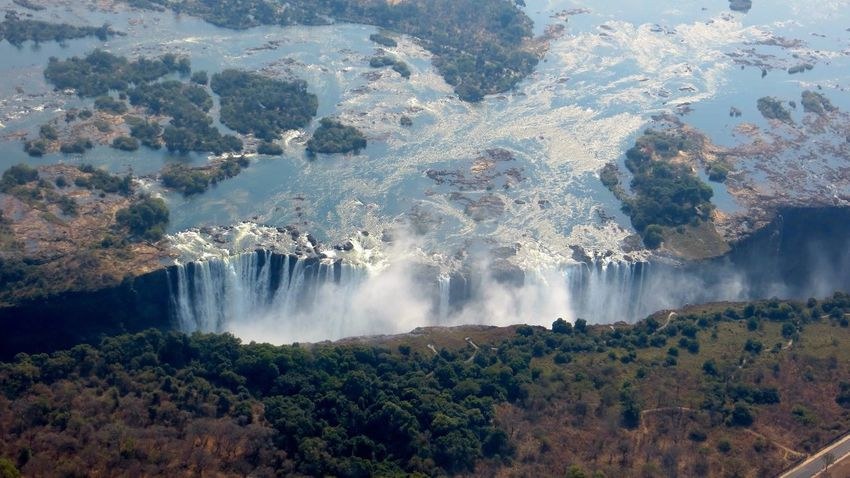 Victoria Falls from a Helicopter Waterfall Water Nature Beauty In Nature Scenics Tree Motion High Angle View Tranquil Scene No People Long Exposure Forest Day Tranquility Travel Destinations Outdoors Mountain Growth