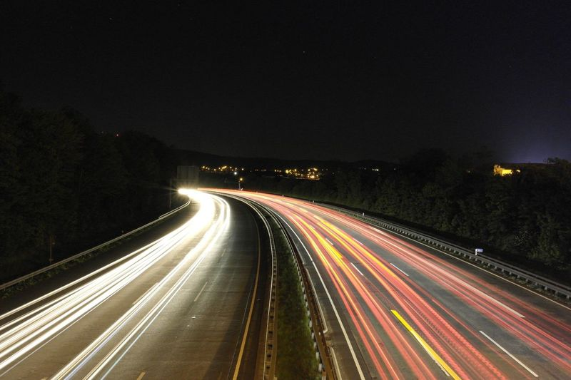 Night Light Trail Long Exposure Illuminated Speed Motion Transportation Traffic Road Outdoors No People High Street Winding Road