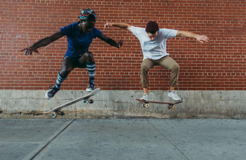 Full length of man running on skateboard