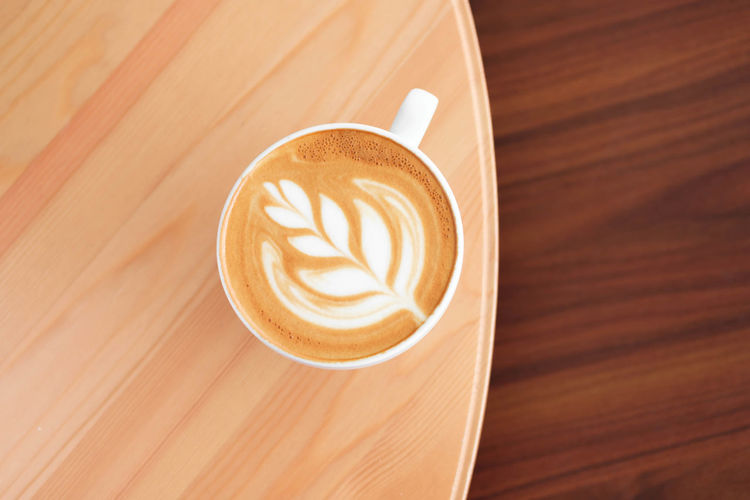 Coffee - Drink Coffee Coffee Cup Cup Mug Drink Refreshment Frothy Drink Froth Art Food And Drink Hot Drink Cappuccino Still Life Wood - Material Latte Table Creativity Indoors  High Angle View Freshness No People Crockery Non-alcoholic Beverage Froth Caffeine
