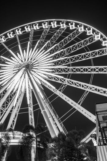 Asiatique The Riverfront Amusement Park Amusement Park Ride Architecture Arts Culture And Entertainment Asiatique Built Structure Carnival Circle Fairground Ferris Wheel Fun Geometric Shape Illuminated Low Angle View Nature Night Nightlife No People Outdoors Sky Spinning Traveling Carnival