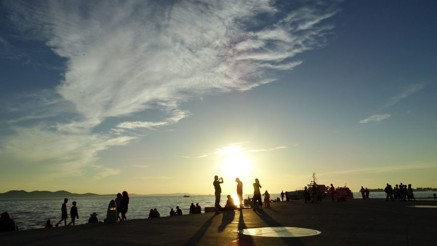 Summer In The City Beach Beauty In Nature Cloud - Sky Crowd Group Of People Horizon Over Water Land Large Group Of People Leisure Activity Men Nature Outdoors Real People Scenics - Nature Sea Sky Sun Sunlight Sunset Water