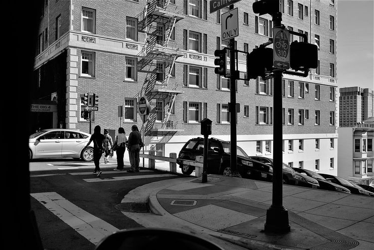 Adult Architecture Blackandwhite Building Exterior Built Structure City Day Firelight Outdoors People Real People Street Streetphotography The Street Photographer - 2017 EyeEm Awards Transportation