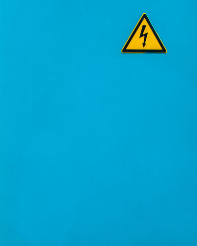 Wallfeature Blue No People Copy Space Wall - Building Feature Minimalism Minimalist Photography  Fujix_berlin Ralfpollack_fotografie Sign Communication Yellow Triangle Shape Warning Sign Shape Information Symbol Information Sign Geometric Shape Arrow Symbol Warning Symbol