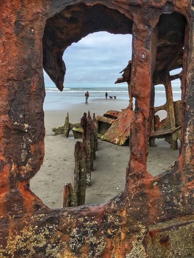 Sea Sky Outdoors Shipwreck Rusted Metal  Rusting Ship Ocean People At The Beach Framed View Shore People The Great Outdoors - 2017 EyeEm Awards