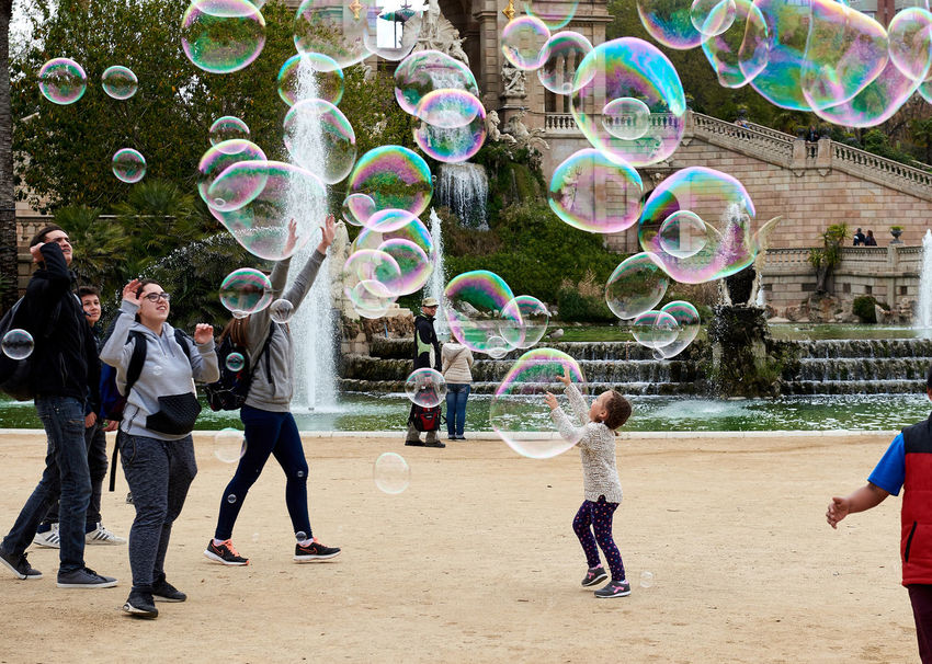 Children catching the soap bubbles in the in the Ciutadella Park in Barcelona. Ciutadella park is one of the finest parks in Barcelona. Park dotted with historic landmarks, statues and fountains Barcelona, Spain Catalonia Childhood Children City Ciutadella Park Crowd Of People Day Entertainment Europe Famous Place Fountain Fun Human Landmark Motion People Show Soap Bubbles SPAIN Spring Tourist Tourist Attraction  Travel Destinations Youth