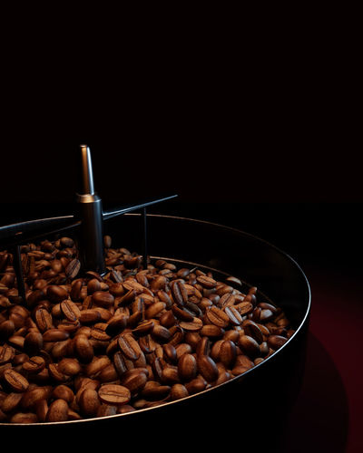 Close-up of coffee beans against black background