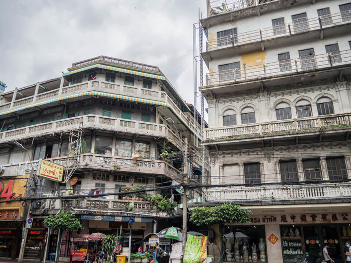 Apartment Architecture Building Building Exterior Built Structure Chinatown, Bangkok City City Life Cloud - Sky Day Group Of People Incidental People Low Angle View Nature Outdoors People Real People Residential District Sky Street Window Women