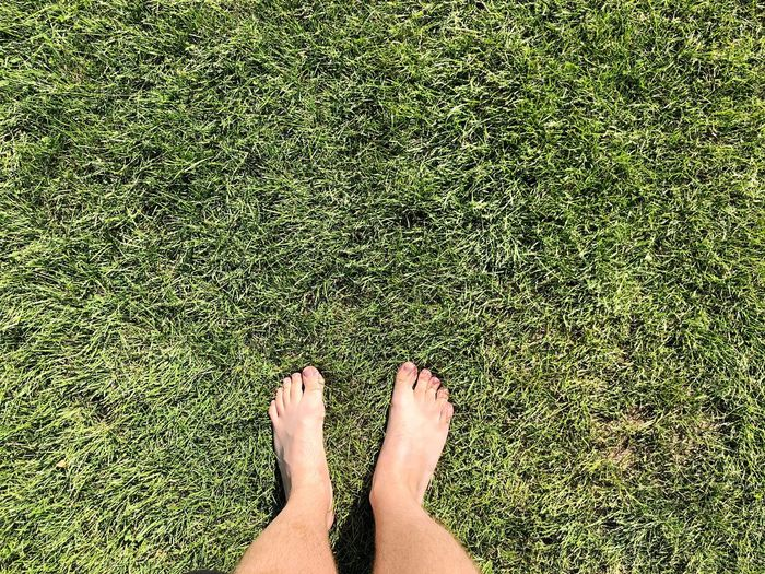 Low section of person legs on field