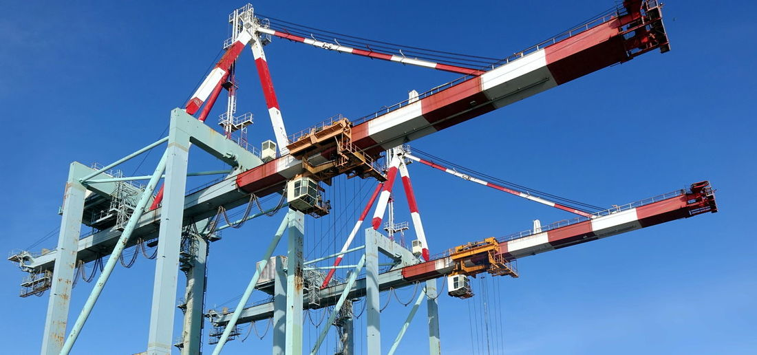 Two large container cranes at the harbor Container Cranes Gantry Cranes Harbor Logistics Cargo Transport Clear Sky Freight Transportation Industrial Equipment Industry Machinery Port Shipping Terminal Transportation