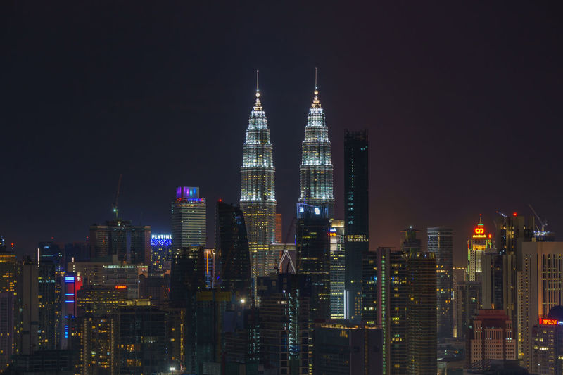Kuala Lumpur icon view at night Architecture Building Building Exterior Built Structure City Cityscape Financial District  Illuminated Landscape Luminosity Modern Night Nightlife No People Office Office Building Exterior Outdoors Residential District Sky Skyscraper Spire  Tall - High Tower Travel Destinations Urban Skyline