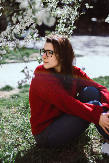 Spring Flowers Spring Springtime Girl March Potrait Potrait_photography Potrait Of Woman Real People Red Glasses Beatiful Girl Model Rainbow Rainbow Colors Plant Young Adult Young Women One Person Tree Lifestyles Women Eyeglasses  Beautiful Woman Outdoors Warm Clothing Sitting Nature Day
