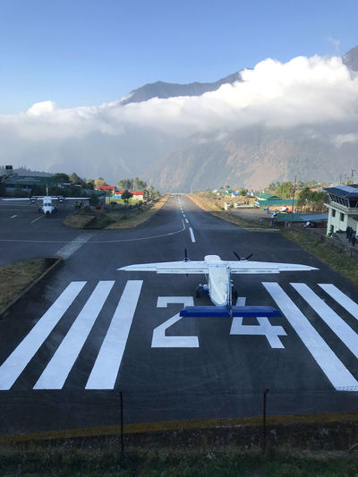 Lukla Airport Dangerous Airport Cloud - Sky Transportation Mountain Sky Airport Outdoors Mountain Range Road Air Vehicle Airport Runway Airplane Adventure Day No People Nature