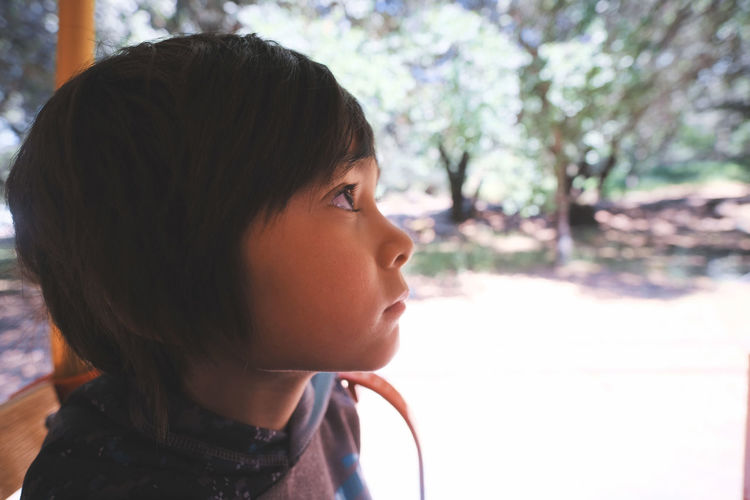 Close-Up Of Thoughtful Boy Looking Away