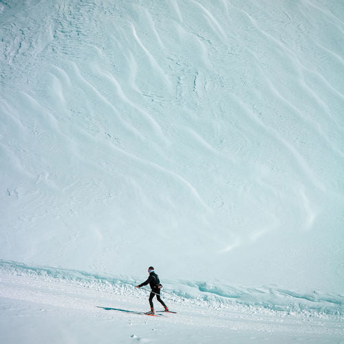 High Angle View Of Man Skiing On Snow Covered Land
