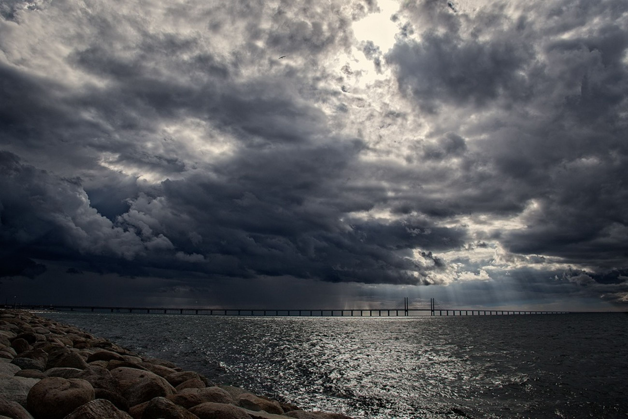 sea, water, sky, cloud - sky, cloudy, scenics, horizon over water, beauty in nature, tranquil scene, tranquility, weather, beach, nature, overcast, shore, storm cloud, rock - object, cloud, idyllic, dramatic sky