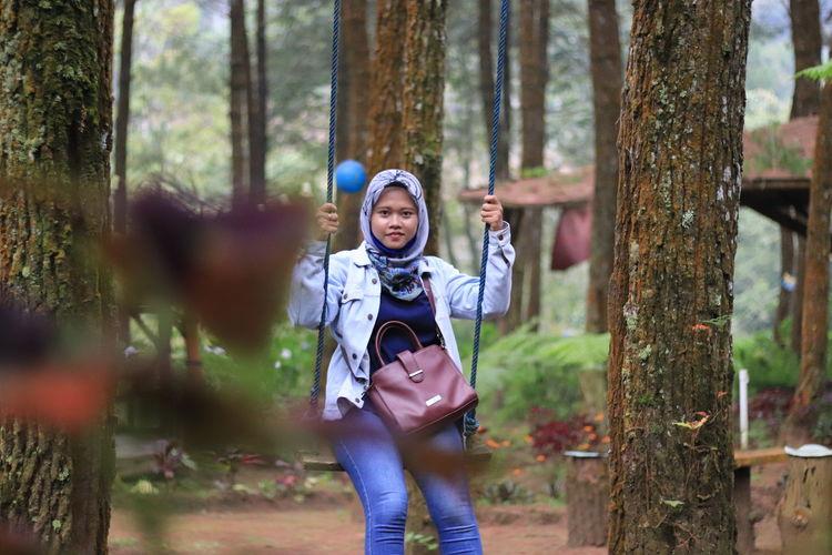 Full length portrait in forest