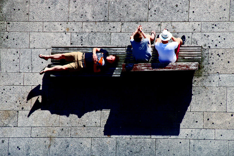 Tourists in different kind of situations Brick Wall Day Furniture Hangover Lifestyles Outdoors Sitting Sleeping Turist