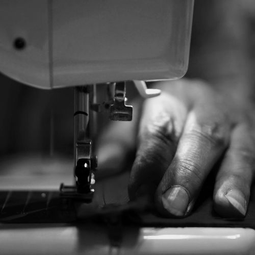 Cropped image of tailor hand sewing cloth