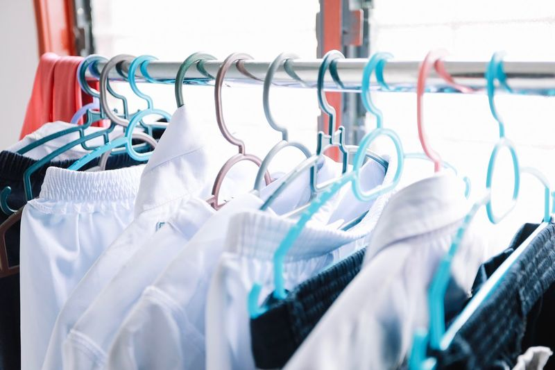 Laundry Coathanger Hanging Rack In A Row No People Clothing Clothes Rack Large Group Of Objects Indoors  Store Retail  Textile Metal Clothing Store Group Of Objects Shopping Business Close-up Choice Repetition