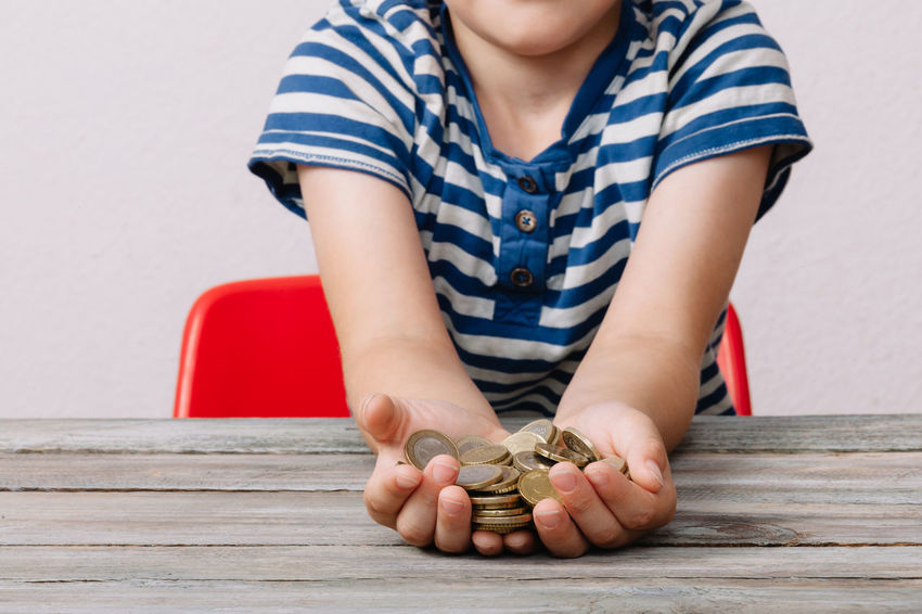 Boy holding coins of money Hands Pocket Money Rich Allowance Boy Cash Childhood Close-up Coin Coins Currency Day Front View Holding Holding On Human Hand Indoors  Many Money One Person People Real People Savings Savings Money