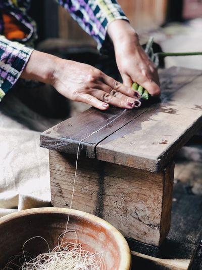 Wood Material Wood Green Color Asian People Woman At Work Hand Work ASIA Hand Human Hand Real People Human Body Part One Person Working Occupation Skill  Focus On Foreground Indoors  Craft Art And Craft Workshop Wood - Material Preparation  Craftsperson Body Part Holding Finger
