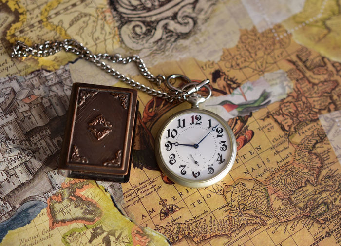 Map Time Watch Pocket Watch Clock Indoors  Guidance World Map Instrument Of Time Antique Direction No People High Angle View Communication Still Life Travel Close-up Exploration Retro Styled Minute Hand Clock Face