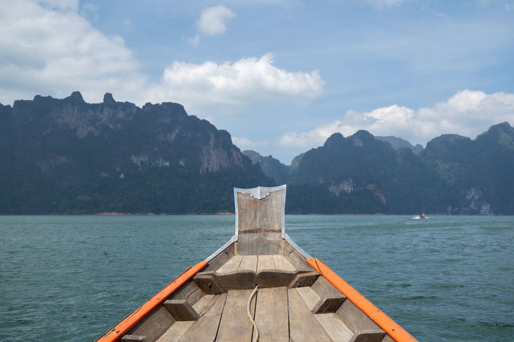 Ship nose front view long tail boat at ratchaprapa dam, suratthani, thailand