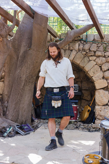 "Jerusalem, Israel, October 03, 2016: Member of the annual festival of ""Knights of Jerusalem"", dressed in a Scottish kilt performs a dance in Jerusalem, Israel Ancient Annual Attraction Christian Citizen Decorations Dressed Event Famous Festival History Holy Israel Jerusalem Knight  Land Medieval Member Old Performance Performs Photographer Pose Sword Tradition"