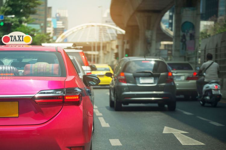 Car Mode Of Transportation Motor Vehicle Transportation City Architecture Land Vehicle Street Building Exterior Built Structure Road Taxi Traffic Day City Life Travel City Street Red Incidental People on the move Taxi Thailand Bangkok Meter Application City Unban